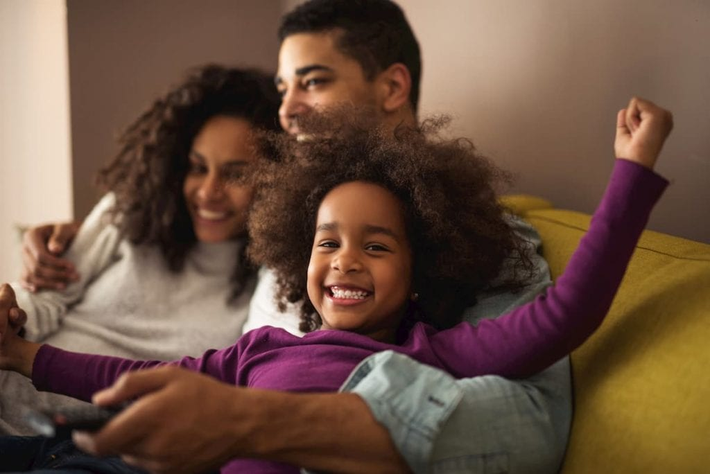 Young black family on couch